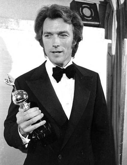 Actor, director and producer Clint Eastwood is shown with his statuette at the Golden Globe Awards in Hollywood, Ca., Feb. 5, 1971.  Eastwood won the award for World Film Favorite, male.  (AP Photo)