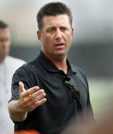 Oklahoma State coach Mike Gundy addresses the team during the first team practice of the fall at the Sherman E. Smith Training Facility on the campus of Oklahoma State University in Stillwater on August 1, 2014. Photo by KT King, The Oklahoman