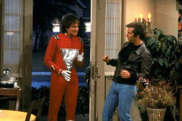 "Robin Williams as Mork and Henry Winkler as Fonzie in the ""Happy Days"" episode ""My Favorite Orkan."" Photo provided."