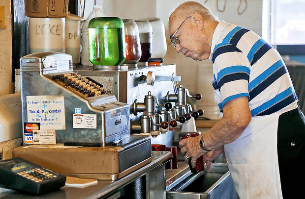 Ballard�s Drive-In owner Johnny Ballard prepares drinks during the lunch hour. He is closing the restaurant Friday. Photos by CHRIS LANDSBERGER, THE OKLAHOMAN