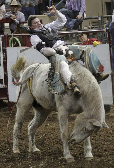 Billy Griffin, of Oak Grove, Missouri, competes in Bareback Bronc during the final performance of International Finals Rodeo at the State Fair Arena in Oklahoma City, Okla., Sunday, Jan. 20, 2013.  Photo by Garett Fisbeck, For The Oklahoman