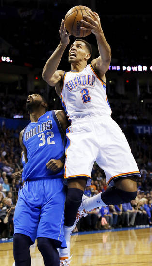 Oklahoma City's Thabo Sefolosha (2) takes a shot past Dallas' O.J. Mayo (32) during an NBA basketball game between the Oklahoma City Thunder and the Dallas Mavericks at Chesapeake Energy Arena in Oklahoma City, Monday, Feb. 4, 2013. Photo by Nate Billings, The Oklahoman