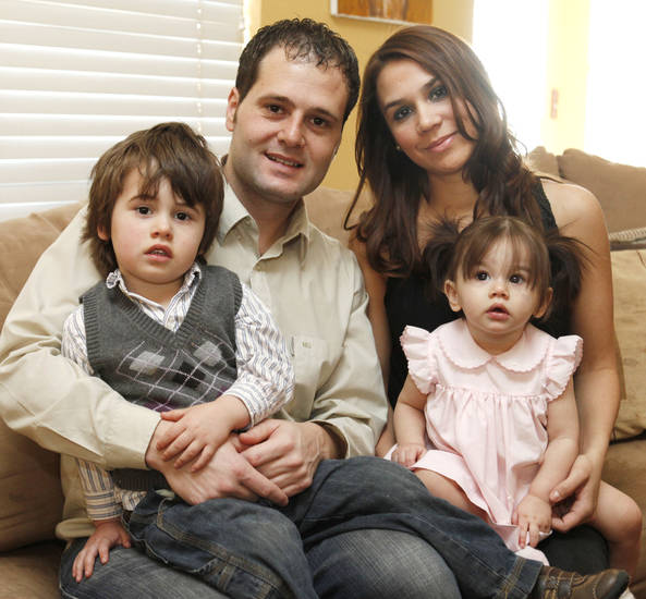Matias Menis and Diana Miller sit with their children Valentin, 3, and Isabella, 11 months, at their home in Norman, OK, Friday, March 11, 2011. By Paul Hellstern, The Oklahoman