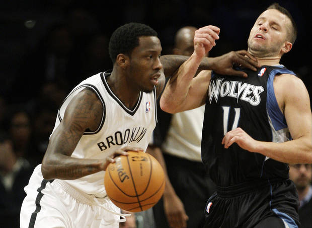 Brooklyn Nets' Tyshawn Taylor, left, drives past Minnesota Timberwolves' Jose Juan Barea during the first half of an NBA basketball game, Monday, Nov. 5, 2012, in New York. (AP Photo/Frank Franklin II)