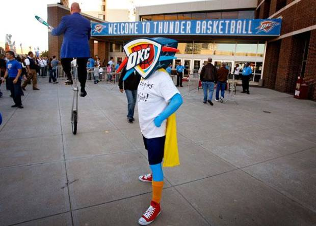 Josh Newby, of Ada, stands outside the Ford Center in his Thunder costume before the opening night NBA basketball game between the Oklahoma City Thunder and the Milwaukee Bucks on Wednesday, Oct. 29, 2008, at the Ford Center in Oklahoma City, Okla.  BY CHRIS LANDSBERGER, THE OKLAHOMAN