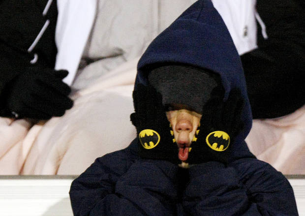 A Kingfisher football fan tries to stay warm during the Class 2A State semifinal football game between Millwood High School and Kingfisher High School on Saturday, Dec. 5, 2009, in Yukon, Okla. 