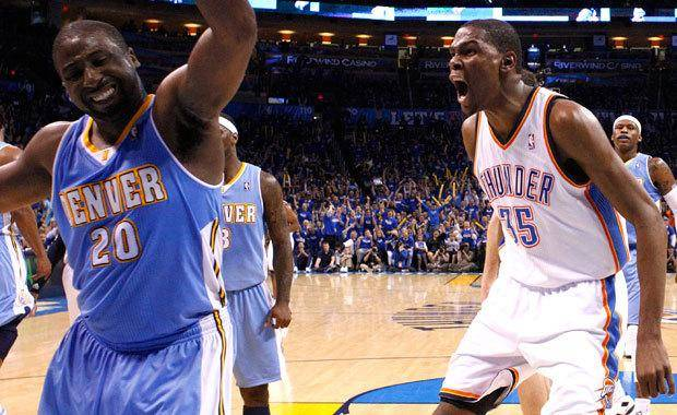Oklahoma City's Kevin Durant (35) reacts after dunking the ball in front of Denver's Raymond Felton (20) during the first round NBA basketball playoff game between the Oklahoma City Thunder and the Denver Nuggets on  Wednesday, April 20, 2011, at the Oklahoma City Arena. Photo by Sarah Phipps, The Oklahoman