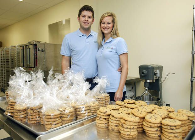 Mac and Heather Carver, Edmond franchisees for Cookie Advantage. <strong>PAUL HELLSTERN - The Oklahoman</strong>