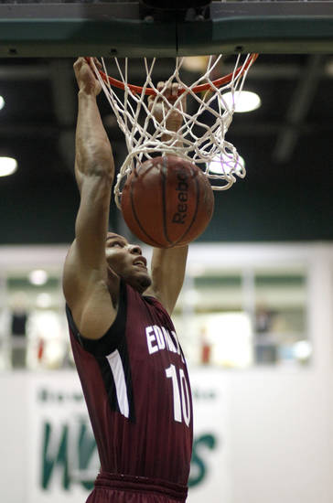 HIGH SCHOOL BASKETBALL: Edmond Memorial's Jordan Woodard dunks the ball during the boys' Edlam basketball game between Edmond Santa Fe and Edmond Memorial at Edmond Santa Fe High School in Edmond, Okla. , Tuesday, Jan. 24, 2012. Photo by Sarah Phipps, The Oklahoman