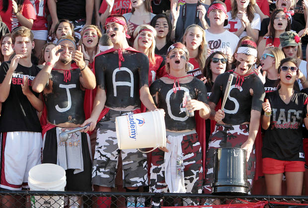 Jaguar fans Wyatt Glasgow, Kyle Dale, Kevin Gay and Evan Crumpley spell out JAGS as The Moore Lions play the Westmoore Jaguars in high school football on Friday, Aug. 31, 2012 in Moore, Okla.  Photo by Steve Sisney, The Oklahoman