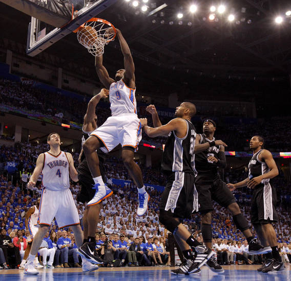 Oklahoma City's Serge Ibaka (9) dunks the ball during Game 4 of the Western Conference Finals between the Oklahoma City Thunder and the San Antonio Spurs in the NBA playoffs at the Chesapeake Energy Arena in Oklahoma City, Saturday, June 2, 2012. Photo by Bryan Terry, The Oklahoman