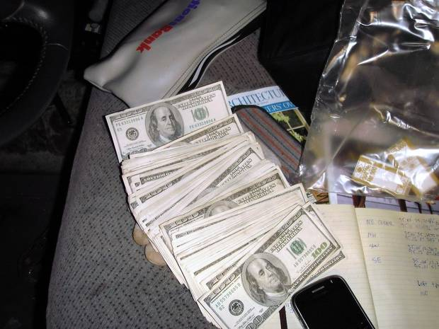 A Latimer County  sheriff's deputy found $32,000 in cash, seen above, in a bank bag beneath the driver's seat of the pickup.