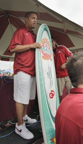 The OU men's basketball head coach Jeff Capel accepts a surfboard during fan fest before the college football game between the University of Oklahoma Sooners (OU) and Florida State University Seminoles (FSU) at the Gaylord Family-Oklahoma Memorial Stadium on Saturday, Sept. 11 2010, in Norman, Okla.   Photo by Steve Sisney, The Oklahoman