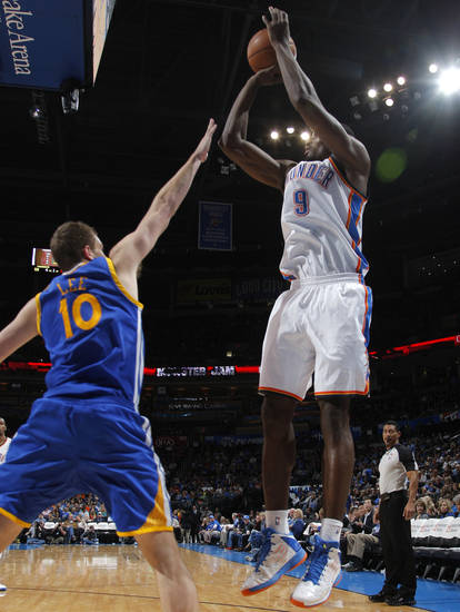 Oklahoma City 's Serge Ibaka (9) shoots over Golden State's David Lee (10) during an NBA basketball game between the Oklahoma City Thunder and the Golden State Warriors at Chesapeake Energy Arena in Oklahoma City, Sunday, Nov. 18, 2012.  Photo by Garett Fisbeck, The Oklahoman