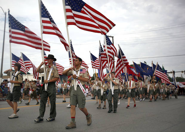 4TH OF JULY / FOURTH OF JULY / ACTIVITIES / FESTIVITIES: Boy Scouts of America troops carry American flags during the LibertyFest Parade in Edmond, Okla., Monday, July 4, 2011. Photo by Sarah Phipps, The Oklahoman ORG XMIT: KOD