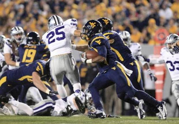 West Virginia's Tavon Austin (1) rounds the corner on a 100-yard kickoff return for a touchdown during the second quarter of an NCAA college football game against Kansas State in Morgantown, W.Va., Saturday, Oct. 20, 2012. (AP Photo/Christopher Jackson)