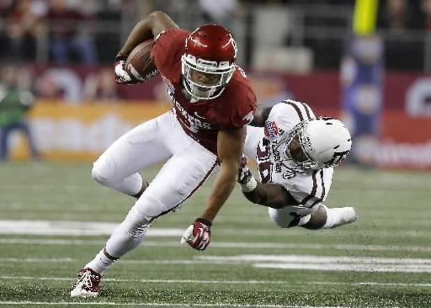 Oklahoma's Sterling Shepard (3) tries to get past Texas A&M 's Deshazor Everett (29) during the Cotton Bowl college football game between the University of Oklahoma (OU) and Texas A&M University at Cowboys Stadium in Arlington, Texas, Friday, Jan. 4, 2013. Photo by Bryan Terry, The Oklahoman