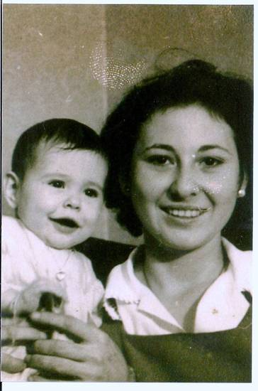 Anna Mae Enlow holds her baby daughter Carol Ann Enlow-Cullum. Photo provided. <strong>Picasa</strong>