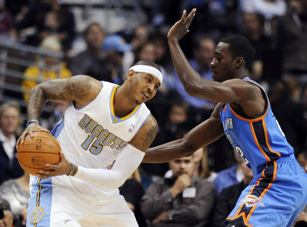 Thunder forward Jeff Green, right, pressures Denver Nuggets forward Carmelo Anthony. AP photo