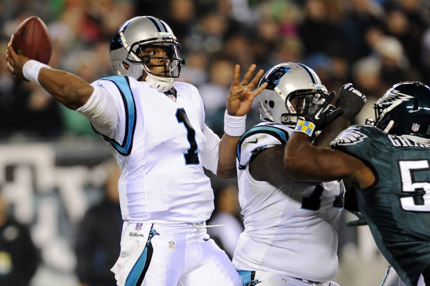 Carolina Panthers quarterback Cam Newton passes in the first half of an NFL football game against the Philadelphia Eagles, Monday, Nov. 26, 2012, in Philadelphia. (AP Photo/Michael Perez)