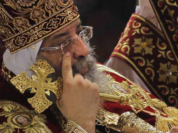 Pope Tawadros II, the 118th pope of the Coptic Church of Egypt, leads a midnight Mass on the eve of Egyptian Orthodox Christmas at St. Mark's Cathedral in Cairo, Egypt, late Sunday, Jan. 6, 2013. (AP Photo/Amr Nabil) ORG XMIT: AMR103