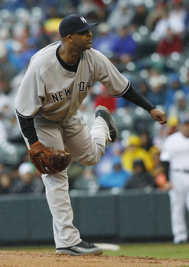 New York Yankees starting pitcher CC Sabathia works against the Colorado Rockies in the first inning of a baseball game in Denver on Thursday, May 9, 2013. (AP Photo/David Zalubowski)
