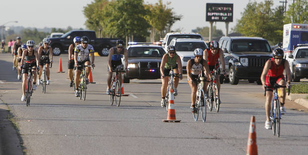Bicyclers pass the intersection of Memorial Rd. and McArthur Blvd. during the Redman Triathlon in Oklahoma City, OK, Saturday, September 22, 2012,  By Paul Hellstern, The Oklahoman