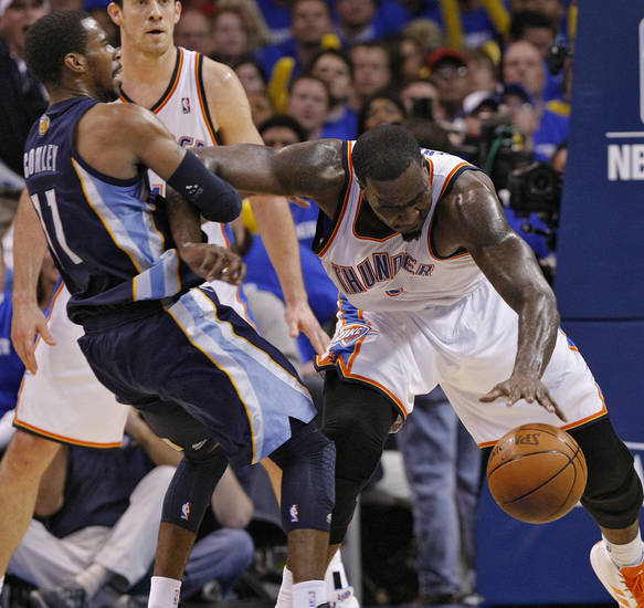 Oklahoma City's Kendrick Perkins (5) clears out Mike Conley (11) of Memphis as he gets a loos ball during game two of the Western Conference semifinals between the Memphis Grizzlies and the Oklahoma City Thunder in the NBA basketball playoffs at Oklahoma City Arena in Oklahoma City, Tuesday, May 3, 2011. Photo by Chris Landsberger, The Oklahoman