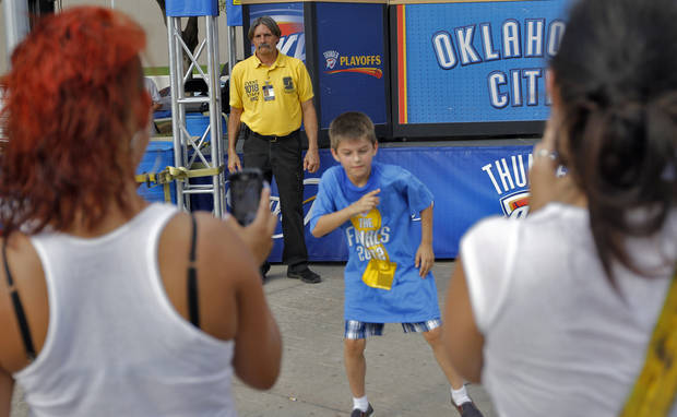 Security Tony Mullins keeps an eye on activity in Thunder Alley during Game 2 of the NBA Finals between the Oklahoma City Thunder and the Miami Heat at Chesapeake Energy Arena in Oklahoma City, Thursday, June 14, 2012. Photo by Chris Landsberger, The Oklahoman