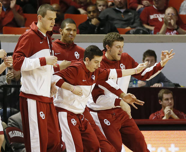 From left,  OU players Casey Arent, James Fraschilla, D.J. Bennett and C.J. Cole play air guitar from the bench after the Sooners hit a 3-point shot during an NCAA men's basketball game between the University of Oklahoma (OU) and Texas Christian University (TCU) at the Lloyd Noble Center in Norman, Okla., Monday, Feb. 11, 2013. Photo by Nate Billings, The Oklahoman
