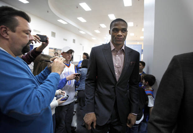 Fans take pictures of Oklahoma City's Russell Westbrook as he leaves a press conference at the Thunder Community Events Center in Oklahoma City, Sunday, Jan. 22, 2012. Photo by Sarah Phipps, The Oklahoman