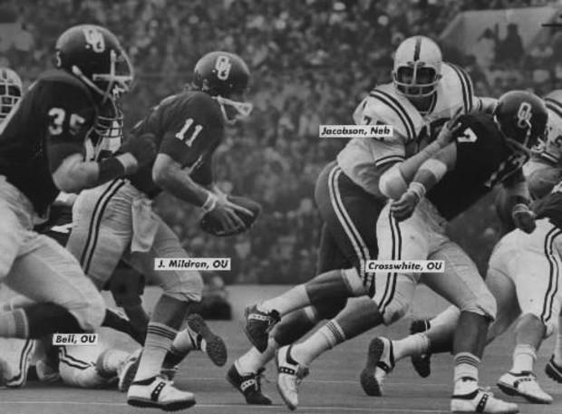 "OU quarterback Jack Mildren takes it down the line as Nebraska's Larry Jacobson looks to pursue during the ""Game of the Century."""