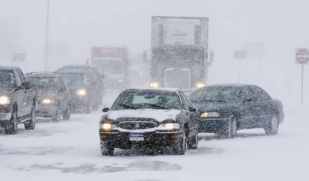 Traffic backs up in blowing snow in El Reno northbound on SH 81 from I-40 after the closure of I-40 Thursday, Dec. 24, 2009. Photo by Paul B. Southerland, The Oklahoman