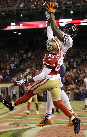 Chicago Bears wide receiver Brandon Marshall catches a 13-yard touchdown pass over San Francisco 49ers cornerback Chris Culliver (29) during the third quarter of an NFL football game in San Francisco, Monday, Nov. 19, 2012. (AP Photo/Marcio Jose Sanchez)
