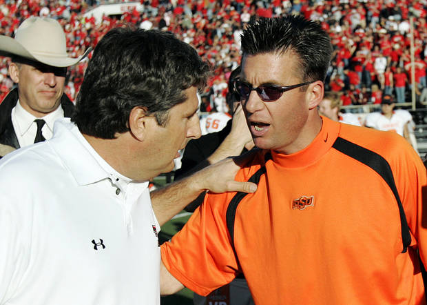 Texas Tech head coach Mike Leach, left, speaks with Oklahoma State head coach Mike Gundy after the college football game between the Oklahoma State Cowboys (OSU) and the Texas Tech Red Raiders (TTU) at Jones AT&T Stadium in Lubbock, Texas, Saturday, Nov. 18, 2006. Texas Tech won 30-24. By Nate Billings, The Oklahoman