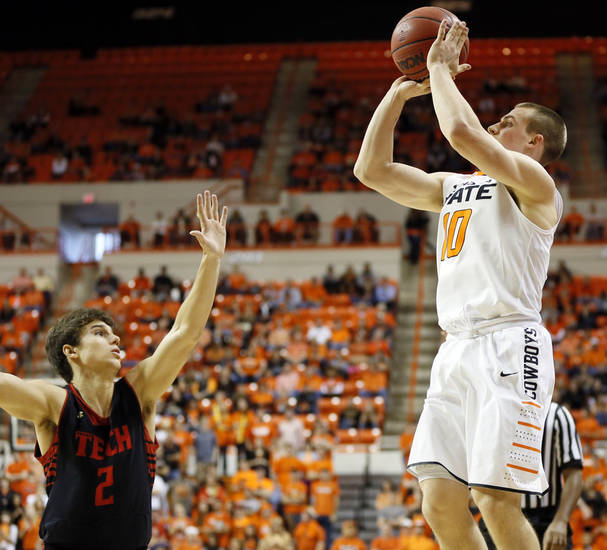 Oklahoma State's Phil Forte (10) shoots a 3-point shot over Texas Tech's Dusty Hannahs (2) during a men's college basketball game between Oklahoma State University (OSU) and Texas Tech at Gallagher-Iba Arena in Stillwater, Okla., Saturday, Jan. 19, 2013.  Photo by Nate Billings, The Oklahoman