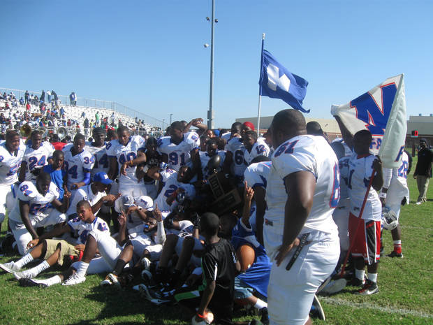 Millwood celebrates after a memorable 36-31 win against Douglass in the Soul Bowl.