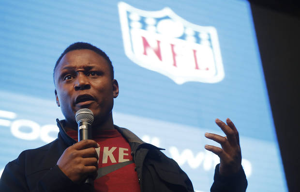 NFL Hall of Fame running back Barry Sanders speaks at the Football Viewing Party in Shanghai, China, on Monday Dec. 3, 2012. (AP Photo) ORG XMIT: XEH105