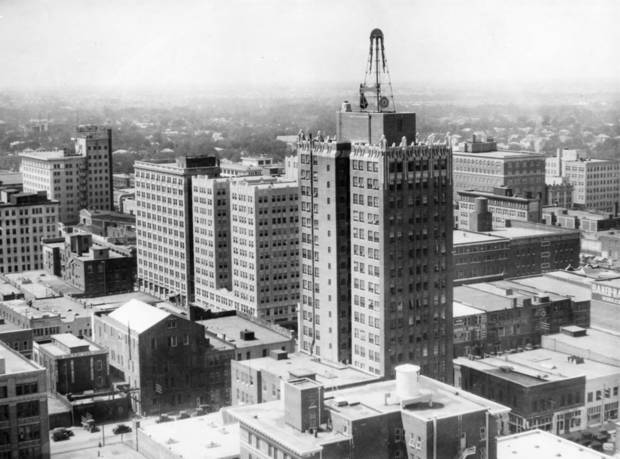 OKLAHOMA CITY / SKY LINE / OKLAHOMA:  From Third and Broadway, looking downtown at part of the skyline and wall of brick.  Principal buildings in the view, right to left: Petroleum, Perrine, First National, American First, and Colcord.  Photo undated and published on 09/07/1930 in The Daily Oklahoman.
