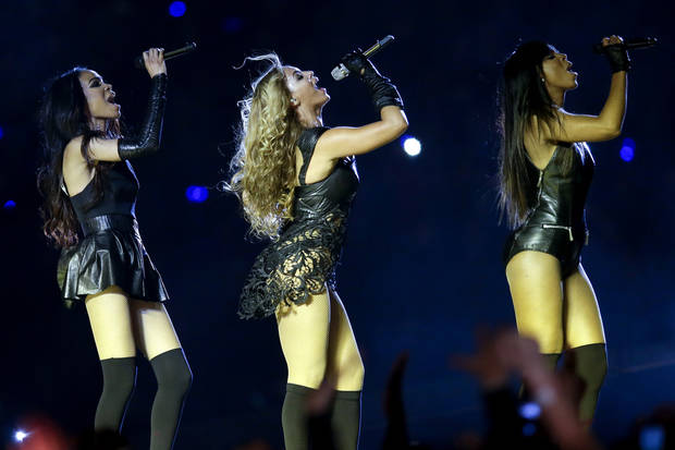 Beyonce, center, Kelly Rowland, right, and Michelle Williams, left, of Destiny's Child, perform during the halftime show of the NFL Super Bowl XLVII football game between the San Francisco 49ers and the Baltimore Ravens, Sunday, Feb. 3, 2013, in New Orleans. (AP Photo/Patrick Semansky)