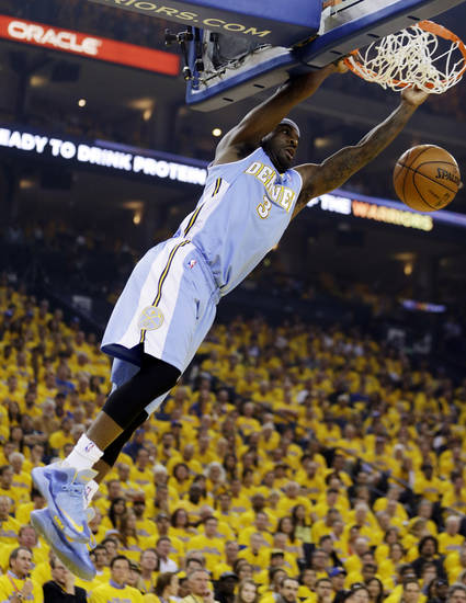 Denver Nuggets' Ty Lawson dunks against the Golden State Warriors during the first half of Game 4 in a first-round NBA basketball playoff series, Sunday, April 28, 2013, in Oakland, Calif. (AP Photo/Ben Margot)