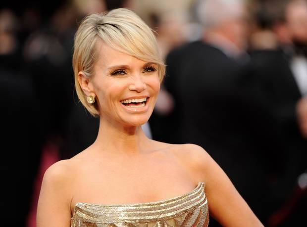 Kristin Chenoweth arrives at the Oscars on Sunday, March 2, 2014, at the Dolby Theatre in Los Angeles. (AP)