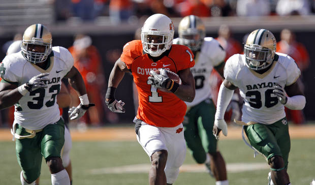 Oklahoma State's Joseph Randle (1) out runs Baylor's Earl Patin and Chris Francis (36) during the college football game between the Oklahoma State University Cowboys (OSU) and the Baylor University Bears at Boone Pickens Stadium in Stillwater, Okla., Saturday, Nov. 6, 2010. Photo by Chris Landsberger, The Oklahoman