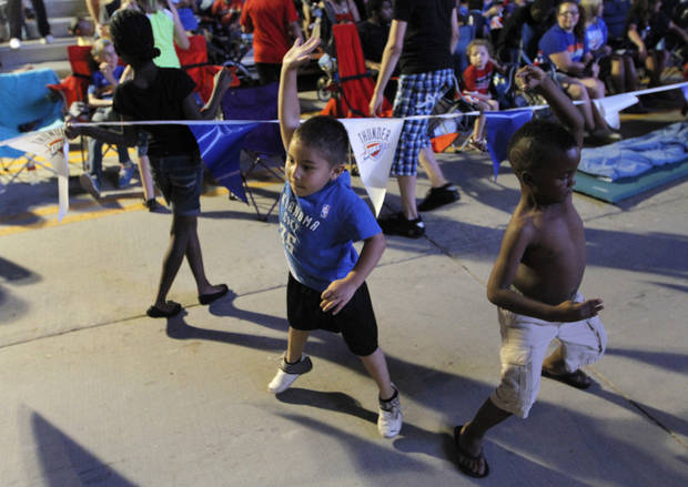 Adain Arovar, 4, and Jureny Ware, 4, dance at Love's Thunder Alley, Monday, April 30, 2012.  Photo by Garett Fisbeck, For The Oklahoman