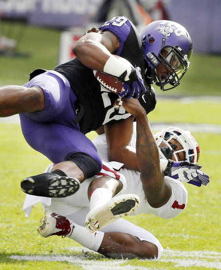 Oklahoma's Tony Jefferson (1) brings down TCU's Matthew Tucker (29) during the college football game between the University of Oklahoma Sooners (OU) and the Texas Christian University Horned Frogs (TCU) at Amon G. Carter Stadium in Fort Worth, Texas, on Saturday, Dec. 1, 2012. Photo by Steve Sisney, The Oklahoman