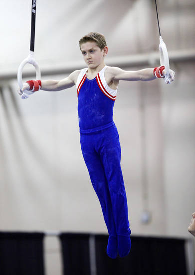 Ethan Kahn with the Bart Conner Gymnastics Academy competes on the rings during the Bart Conner International Invitational, part of the Bart & Nadia Sports & Health Festival, at the Cox Convention Center in Oklahoma City, Saturday, Feb. 11, 2012. Photo by Nate Billings, The Oklahoman