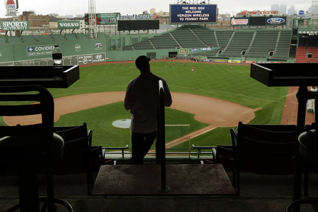 A man looks out over the field at Fenway Park in Boston, Thursday, Oct. 4, 2012, one day after the Boston Red Sox wrapped up a disappointing baseball season with a loss to the New York Yankees and finished in last place for the first time in 20 years. (AP Photo/Elise Amendola)