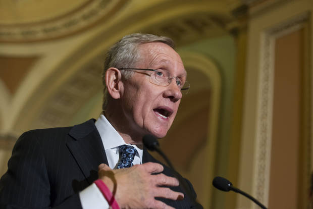 Senate Majority Leader Harry Reid of Nev. answers questions on the looming automatic spending cuts following a Democratic strategy session, Tuesday, Feb. 26, 2013, on Capitol Hill in Washington.  Reid also responded to House Speaker John Boehner who used salty language earlier in the day to prod the Senate to act on legislation to replace the automatic spending cuts known as the sequester.  (AP Photo/J. Scott Applewhite)