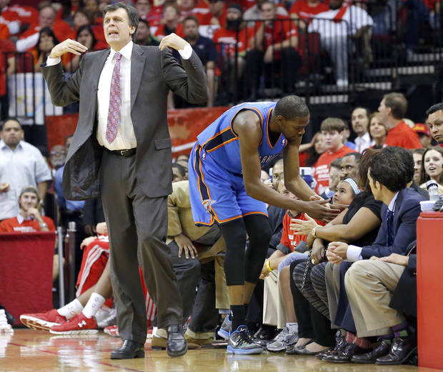 Oklahoma City's Kevin Durant (35) talks with fans after leaping over them as Houston head coach Kevin McHale coaches during Game 4 in the first round of the NBA playoffs between the Oklahoma City Thunder and the Houston Rockets at the Toyota Center in Houston, Texas, Monday, April 29, 2013. Photo by Bryan Terry, The Oklahoman