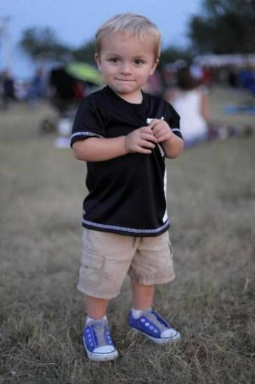 Jace Gaskill, 21 months, walks the Pastures of Plenty during the Woody Guthrie Folk Festival in Okemah, Okla., Thursday, July 12, 2012. Photo by Garett Fisbeck, The Oklahoman